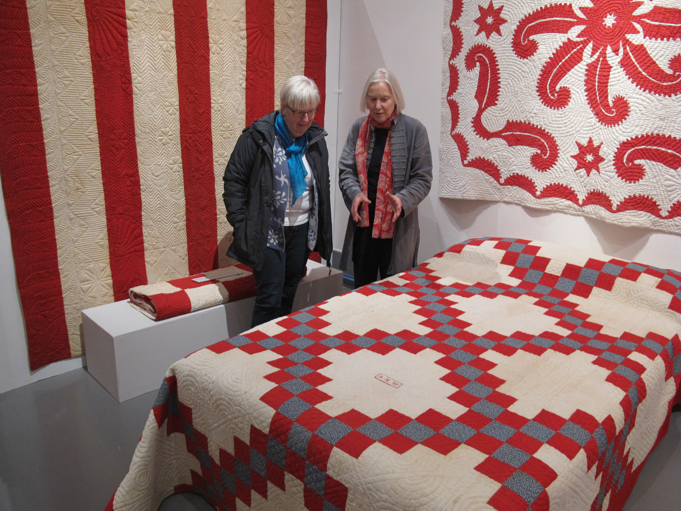 Jen Jones talking to local tourist about quilt on display