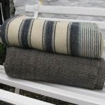 antique blankets on the bench outside Jen Jones
